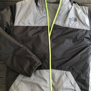 Boys North Face jacket reversible with hood.